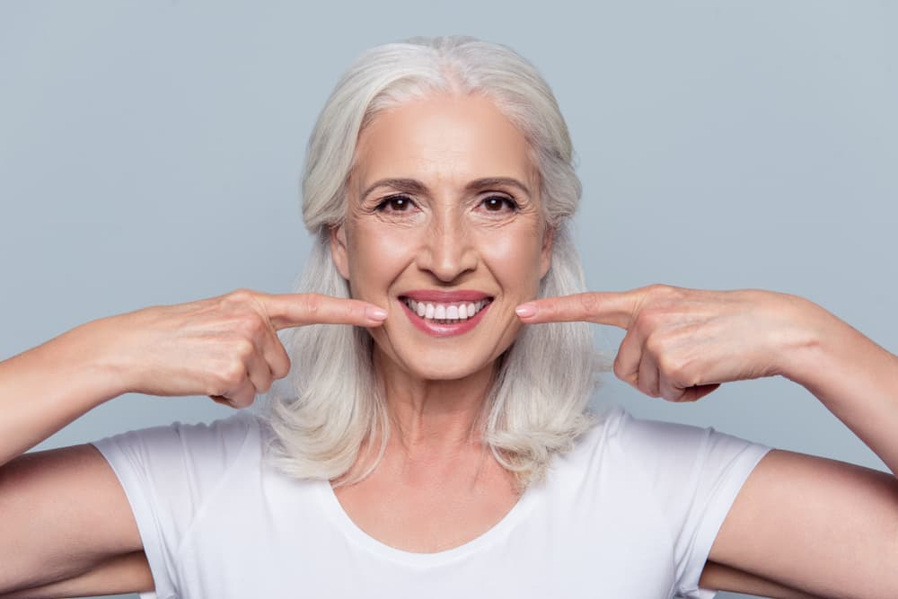 Dental Implants vs Dentures – Pros, Cons, & Differences